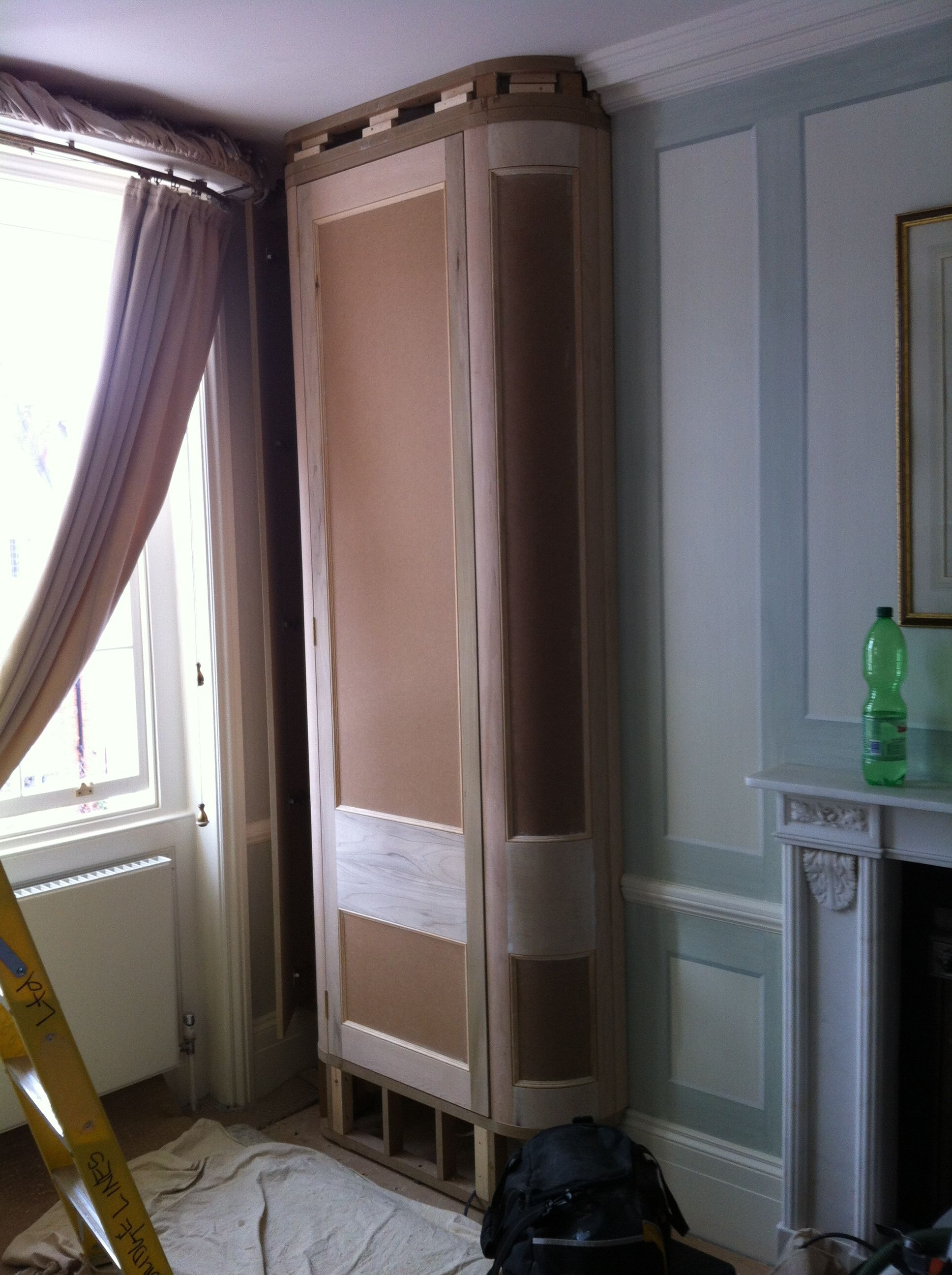 Installation of curved dressing room wardrobe.