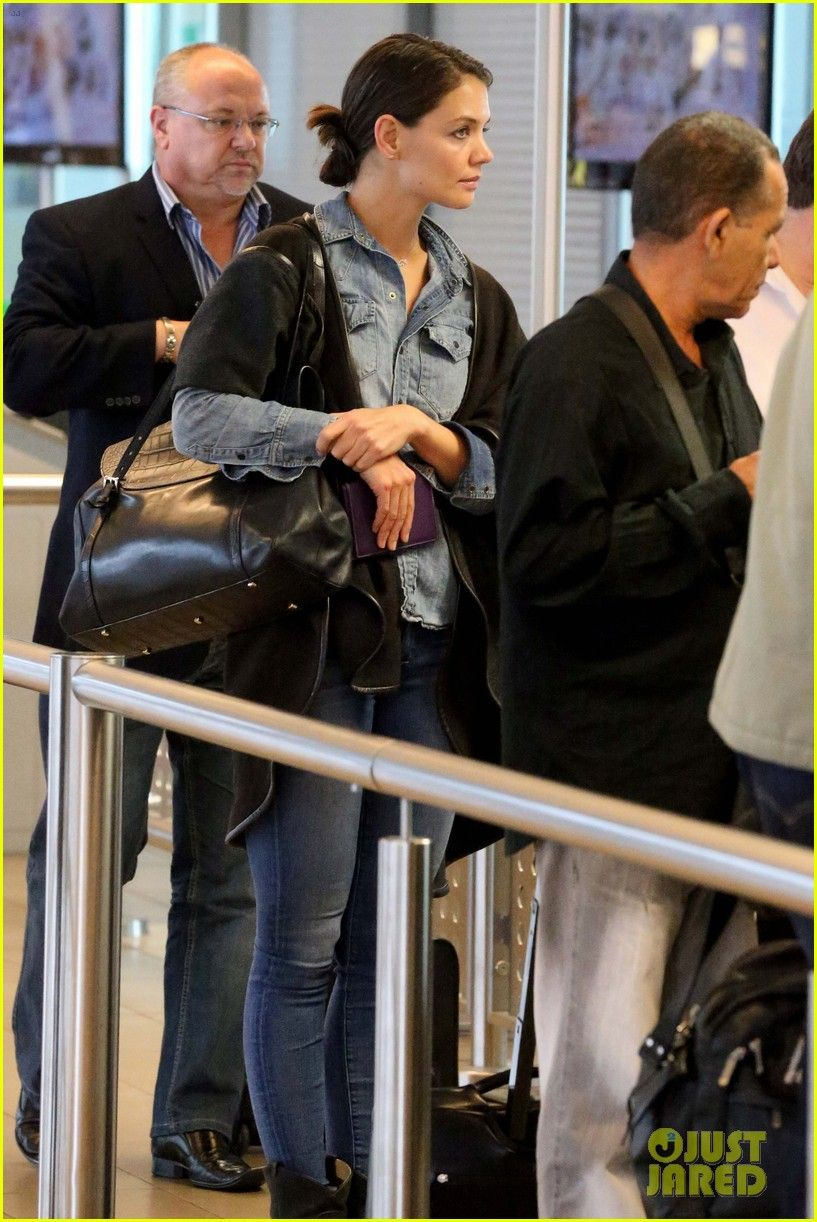 Katie Holmes wears a denim shirt while heading into the airport to catch a flight out of town on Tuesday (November 26) in Cape Town, South Africa.