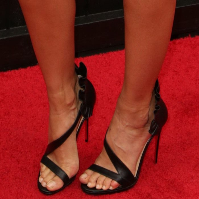 b4f717a5b18 Stephanie Sigman showed off her feet in black patent leather ...