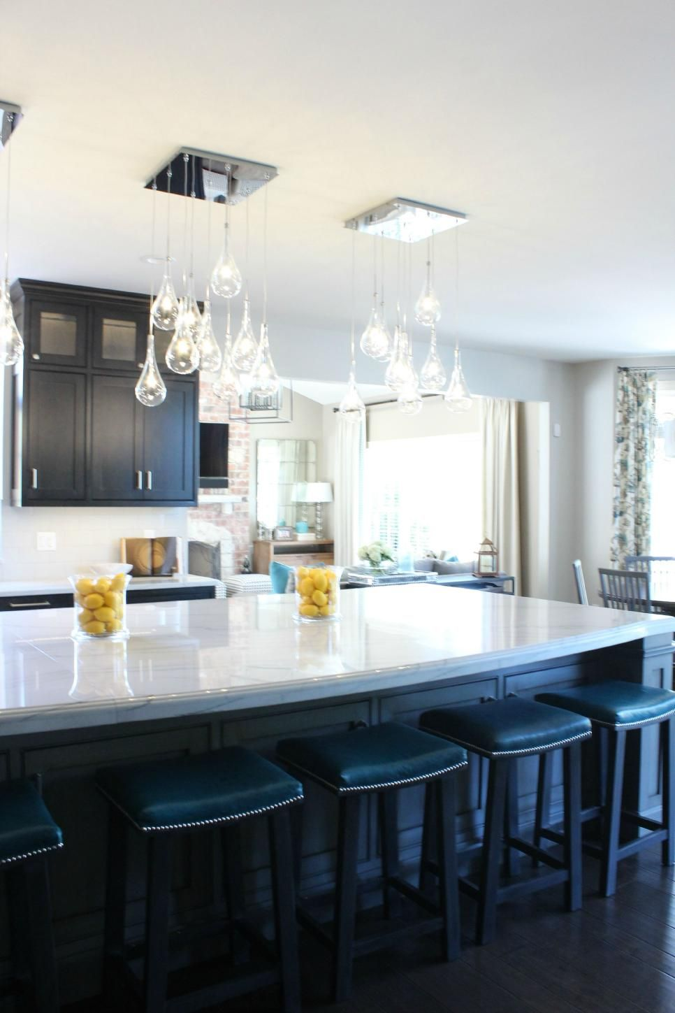 Clusters Of Glass Pendant Lights Dangle Over This Large