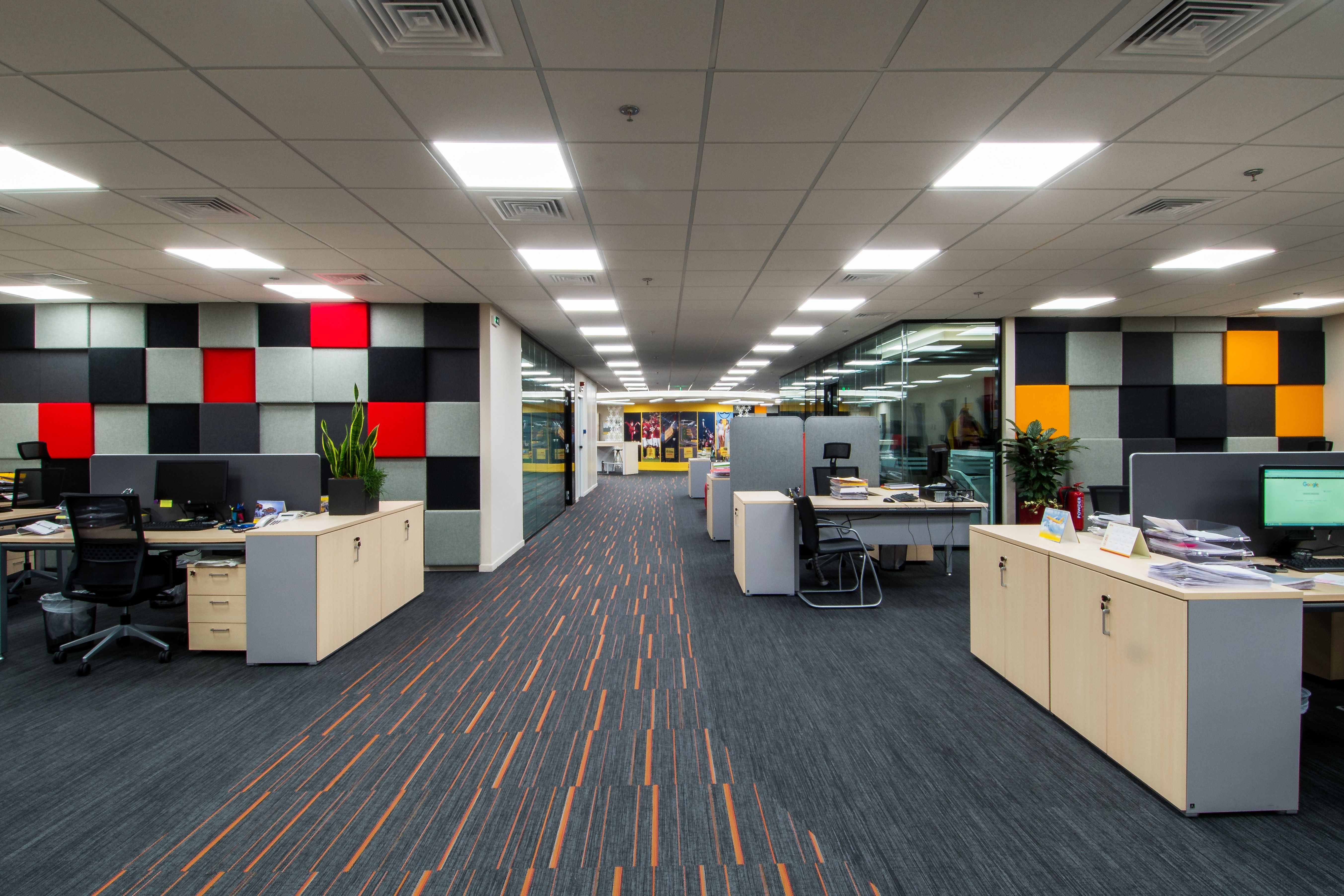 Nice match with the DHL company colours. Open office space