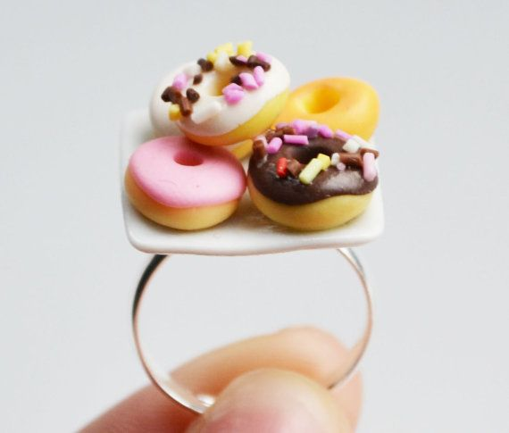 Hey, I found this really awesome Etsy listing at http://www.etsy.com/listing/95477996/doughnut-donut-ring-miniature-fimo