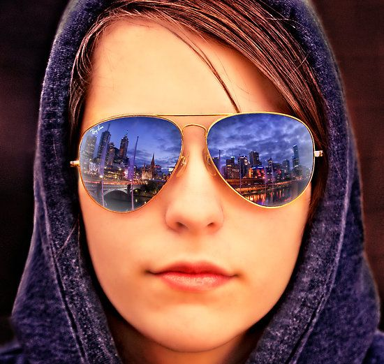 2b15948112b480 City Reflection by Alf Caruana. A cityscape is reflected in the sunglasses.