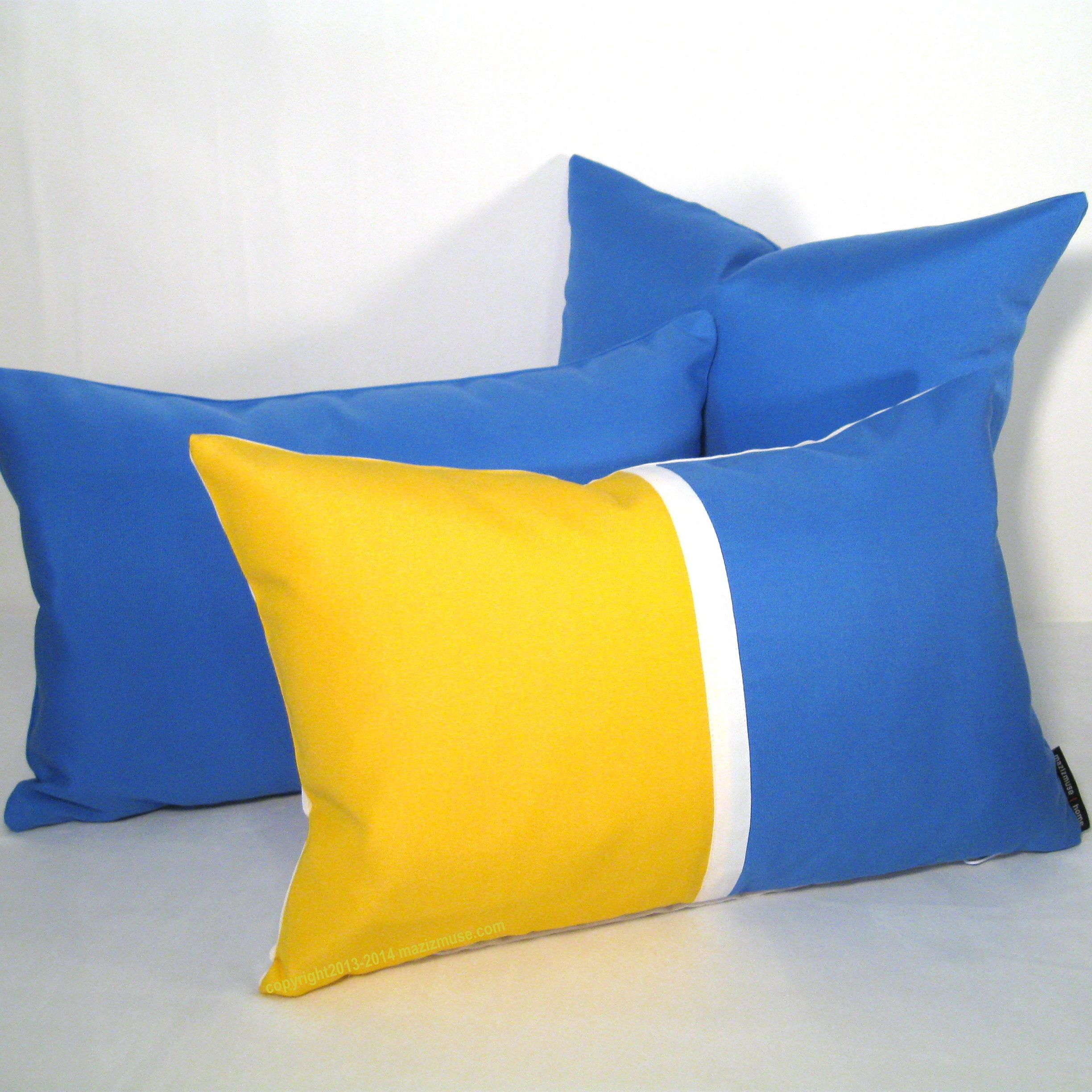 Sky blue and lemon yellow color block pillow crafted from Sunbrella indoor outdoor fabric. #mazizmuse #ColorfulPillows #ColorBlockPillow #ModernNurseryDecor