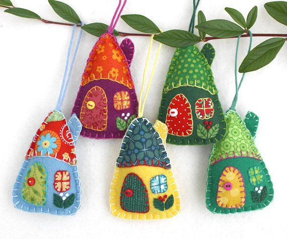 Colourful patchwork Christmas ornaments. Set of three little felt houses, handmade from felt and fabric. The roofs, doors and windows are hand- appliqued using colourful vintage cottons, embroidered berries grow on the walls, and the door knobs are tiny buttons.  Approx 8cm / 3 inches high.  I will send three houses in a range of colours. If there are particular colours you would like, please let me know in the message to seller box at the checkout.