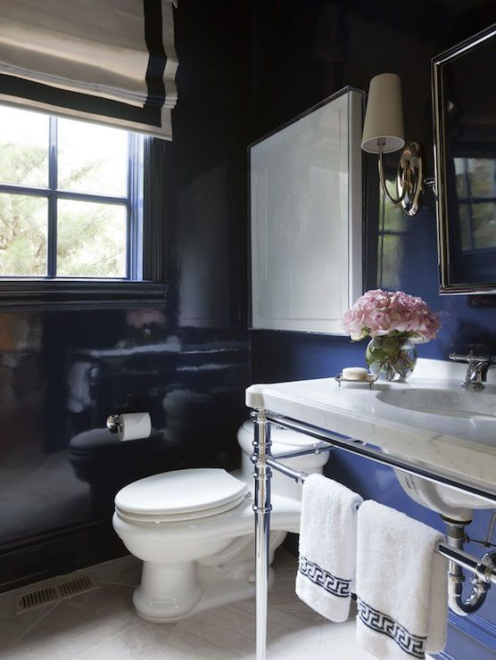 Powder room boasts navy lacquered walls framing window for Bathroom ideas navy blue