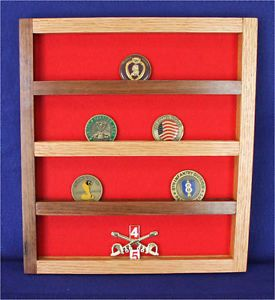 """This item is made of rough oak and walnut wood, it is not stained, just clear coated with a clear gloss finish. Holds 20 military unit coins based on a 2"""" coin, has red felt and comes with hardware to hang it with.     Item is 12 3/4"""" tall,  11 1/2"""" wide and 1"""" thick.  COINS NOT INCLUDED.  Made in the USA by a Veteran and his family."""