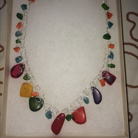 Nicaraguan artisan seed necklace Truly one of a kind. Artist hand knits metal and stranded with Nicaraguan rain forest seeds. These are very vibrant; picture does not do the colors justice. Jewelry Necklaces