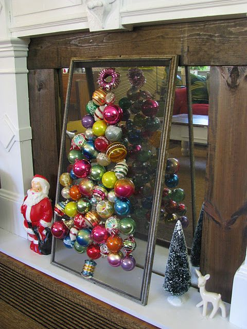 tree made out of vintage ornamentscould use an old window screen and hang the ornaments on it