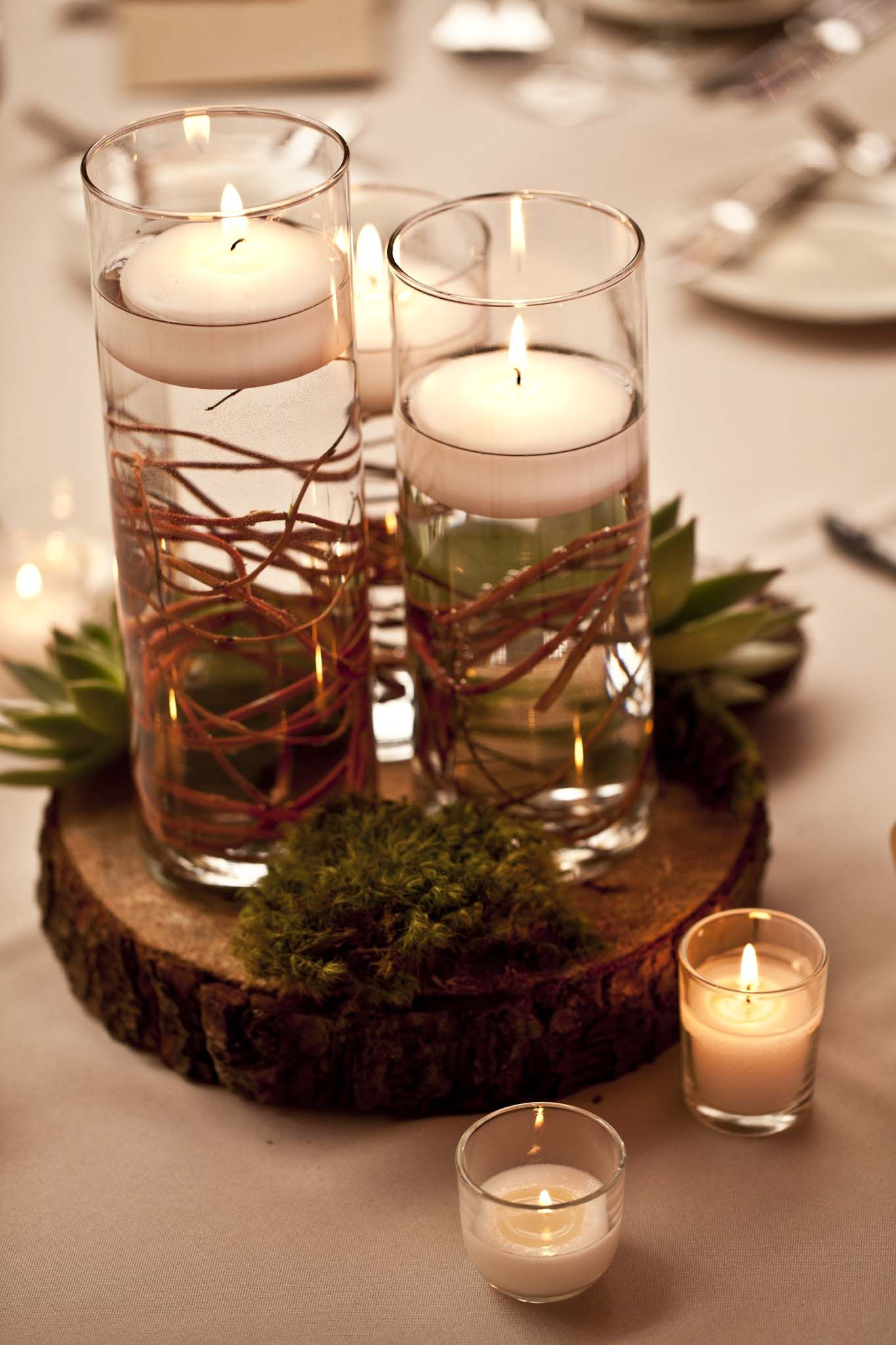 From Alexandra And Adam S Wedding Wood Slab Centerpiece Wood Centerpieces Wooden Slab Centerpiece