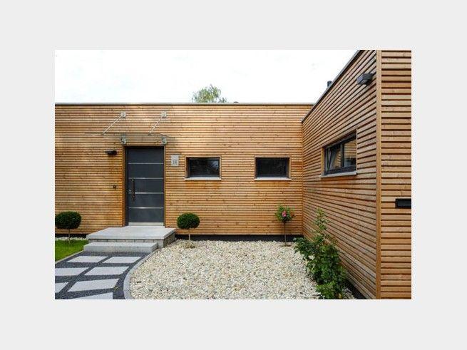 Holzhaus bungalow flachdach  Bungalow Modern - Einfamilienhaus von Baufritz | HausXXL #modern ...