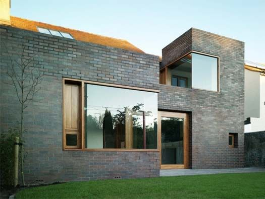Gray brick with wood trim