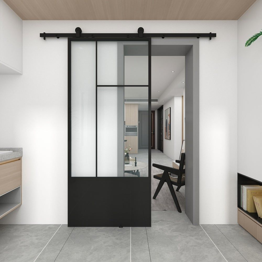 Instantly modernize your living space with the Cicero sliding barn door from the Metro collection. The combination of contemporary design with an industrial influence will be sure to make a statement in any room of your home. Using only quality materials such as tempered glass and powder coated steel frame, paired with a sturdy rail system, this door will help to convert your living space into a functional masterpiece. Steel door with durable black powder coated finish Installation hardware incl