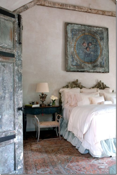 Soft country bedroom style. Terracotta floor, white linens and robin's egg/teal blue accents.