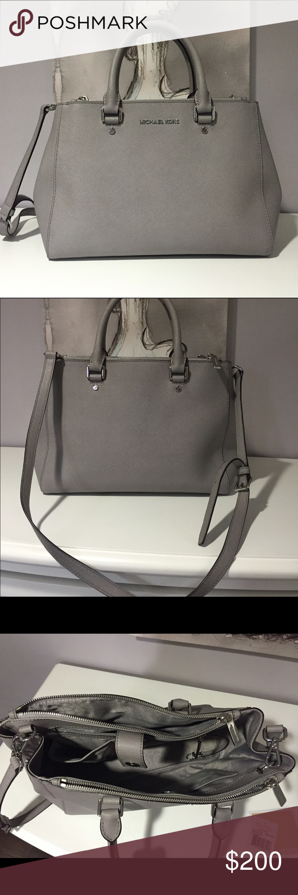 """MICHAEL KORS SAVANNAH MED SAFFIANO LEATHER SATCHEL MICHAEL KORS SAVANNAH MEDIUM GREY SAFFIANO LEATHER SATCHEL - Condition: Like new - Material: Saffiano Leather - Dimensions: 12.5""""W X 8.5""""H X 5""""D - Adjustable Strap: 21""""-24"""" - Interior: 1 Center Zip Compartment, 2 Open Compartments, 1 Open Pocket, 1 Zipper Pocket, 1 Key Chain - Magnetic Snap Fastening - Lining: 100% Polyester - Retails: $328 Asking $200 - Comes with dust bag and tags - From smoke free home - Sorry, no trades - Michael Kors…"""
