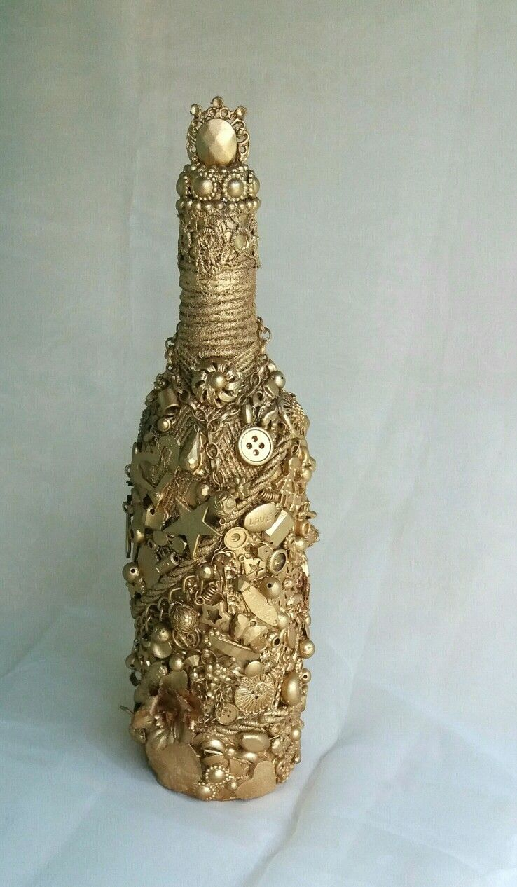 Garrafa decorada dourada