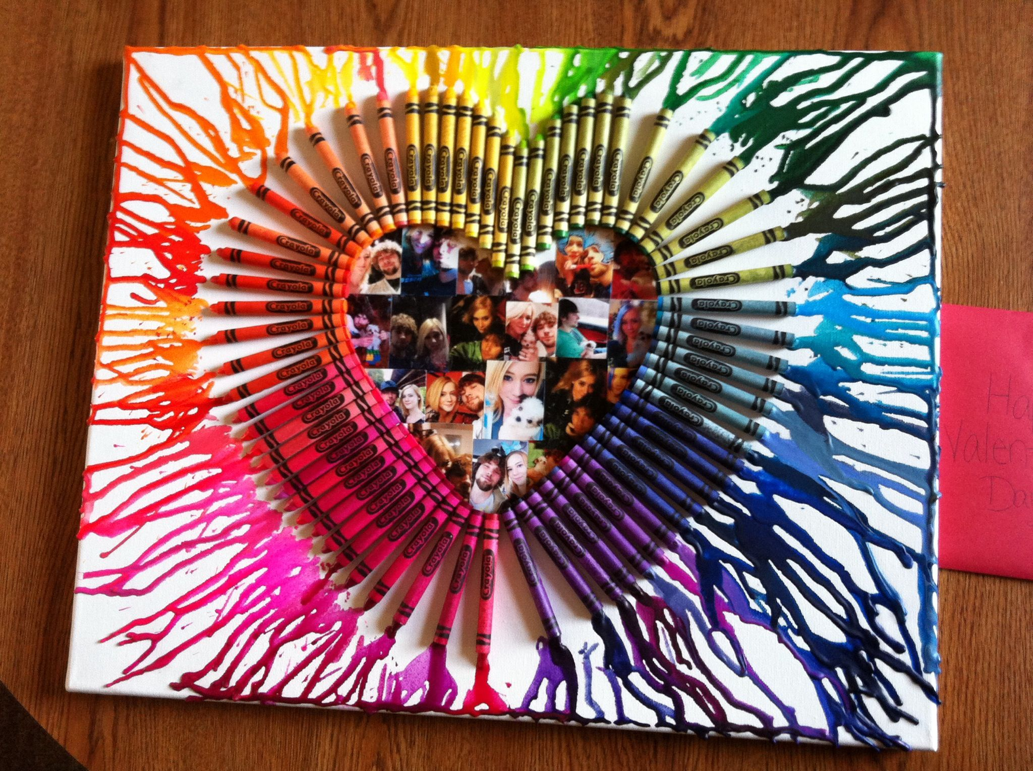 Melted Crayon Heart. I made for Valentines Day for my boyfriend, All you do is hot glue crayons into a shape on a canvas, then melt them with a blow dryer. Tip the canvas to make it melt a certain way or to splatter a certain way, Then if you want you can glue pictures inside too :) #crayonheart