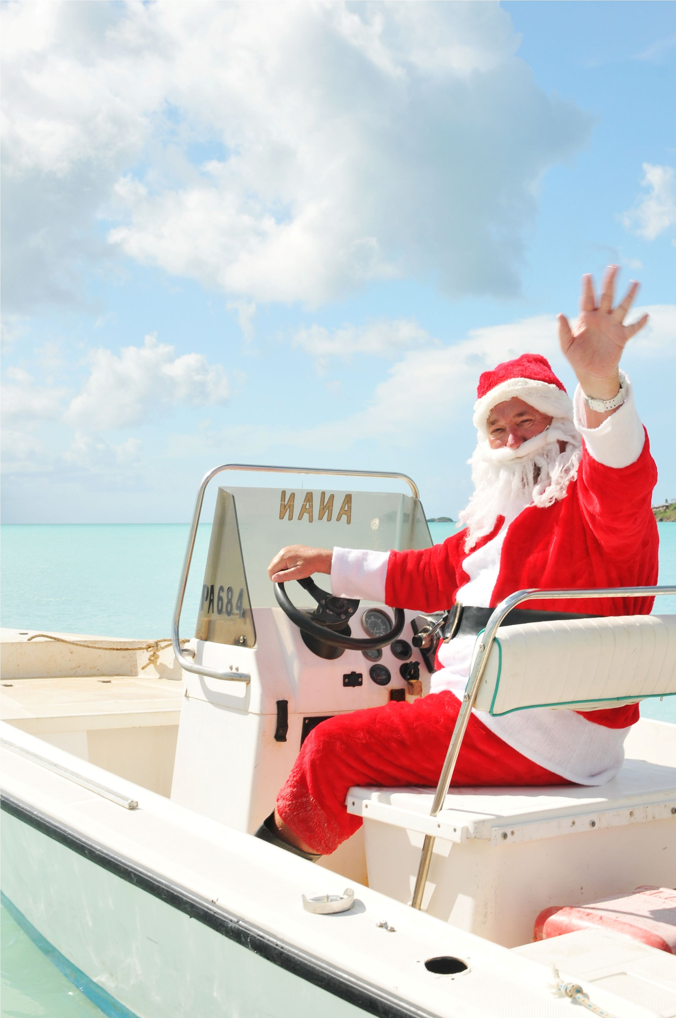 Santa delivering presents by boat this year. Book your next sailing ...