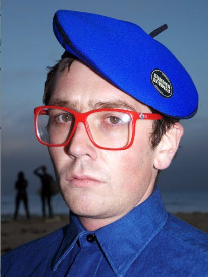 Neoprene beret. Definitely a beach necessity. Plus the Bill Gates glasses.  I like simply because I dig computer geeks and think he must have a decent collection of brittish newwave.