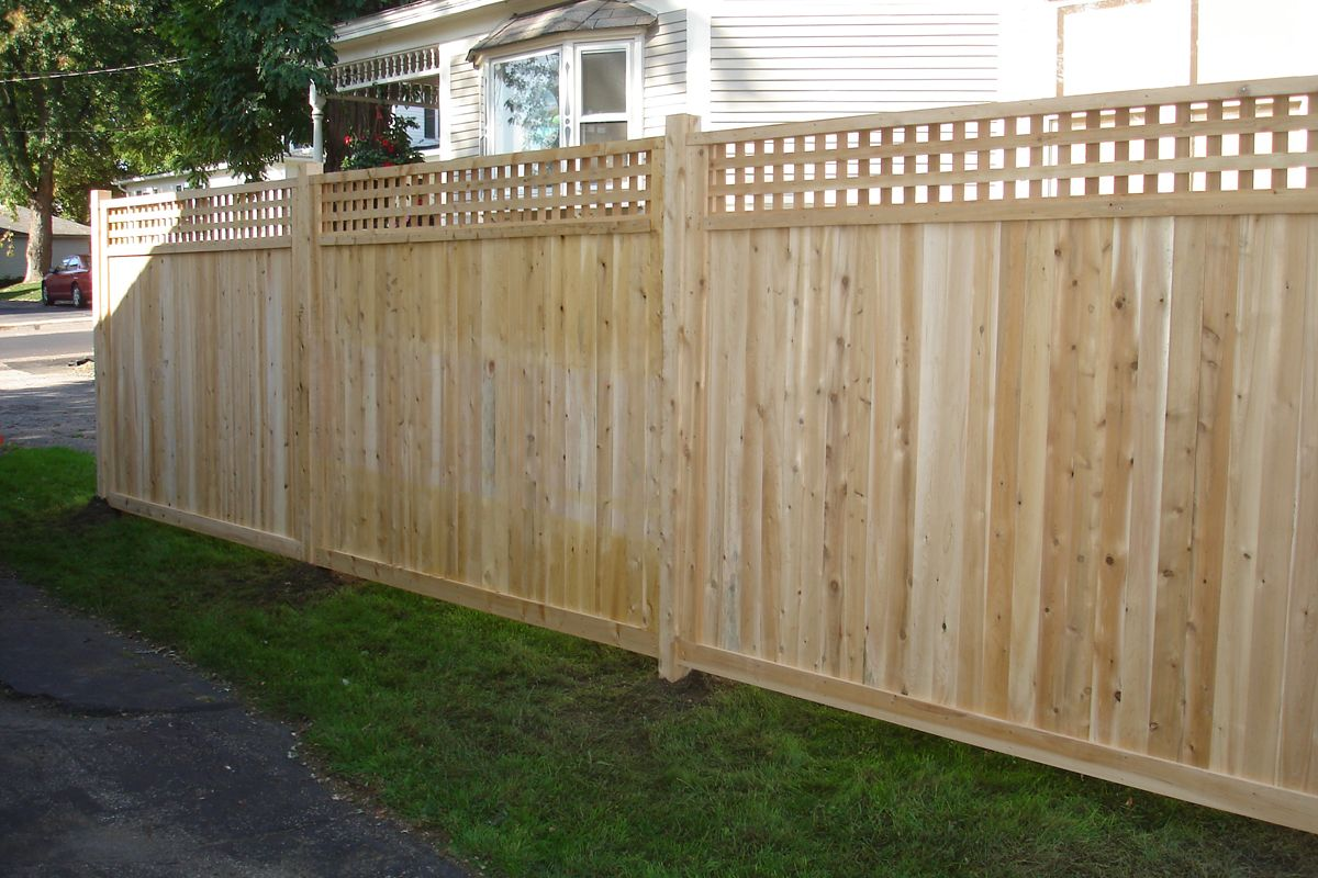 Board on board fence with wide square lattice fence topper for Lattice privacy fence ideas