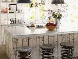whitewashed barnboard and old spring stools - farmhouse style