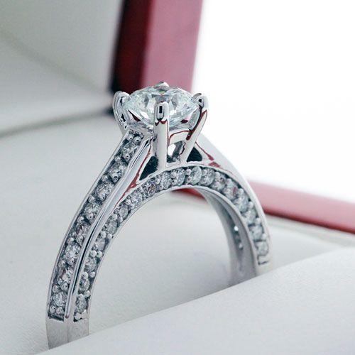 0.70 Carat Round Diamond Mounted onto a Three-Side Diamond Engagement Ring.