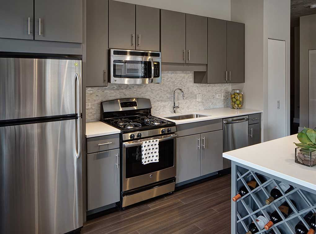 Fully Equipped Kitchens With Stainless Steel Ge Energy Star Appliances Slate Gray Kitchen Cabinets With Designer Tile Backsplashes Modern Fixtures With
