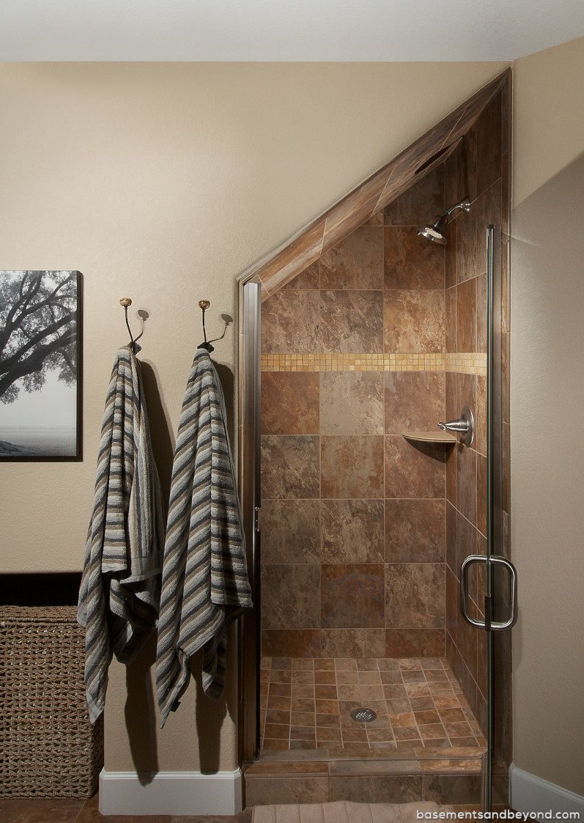 Parker Walk Out Basement Remodeling By Basements Beyond Incorporating Every Inch Of Spa Bathroom Under Stairs Small Bathroom Remodel Basement Remodeling
