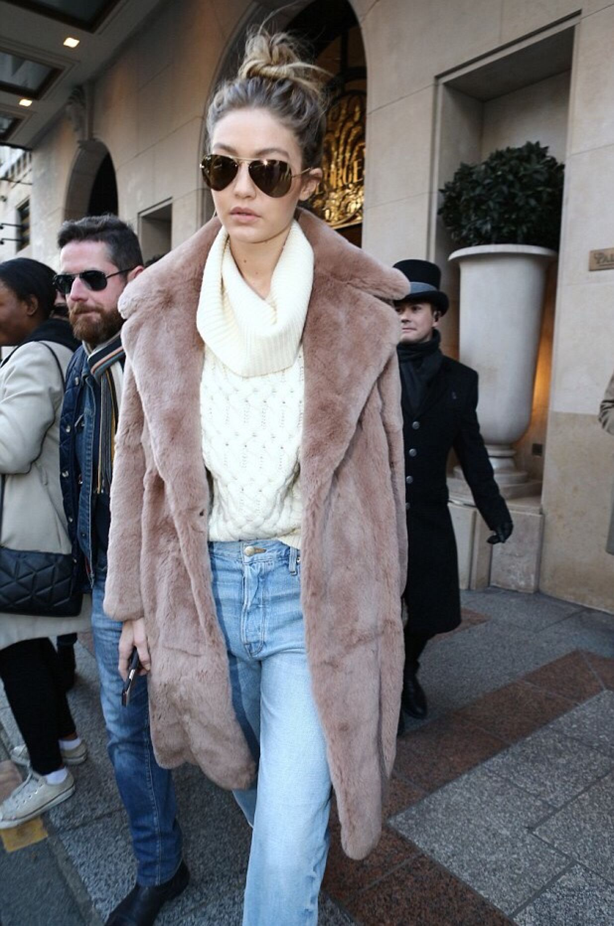 Gigi looked so great in a white turtleneck sweater, dusty rose fur coat, and light wash jeans.