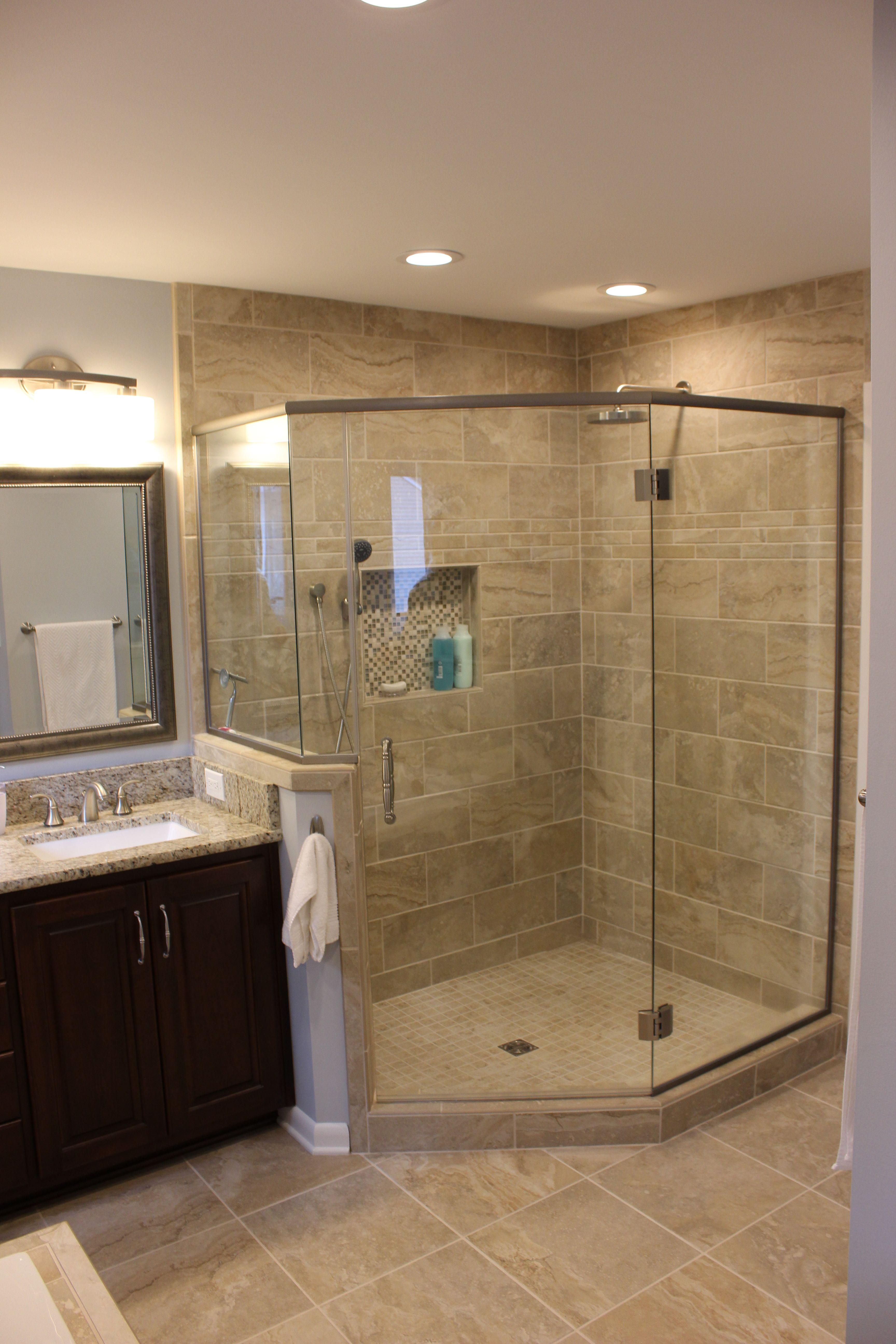 corner shower with 12x24 tiles soap niche and kerdi drain schlutersystem bathrooms remodel corner shower walk through closet