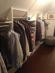 And large walk in attic closet features a white middle island fitted taking into… Banyo