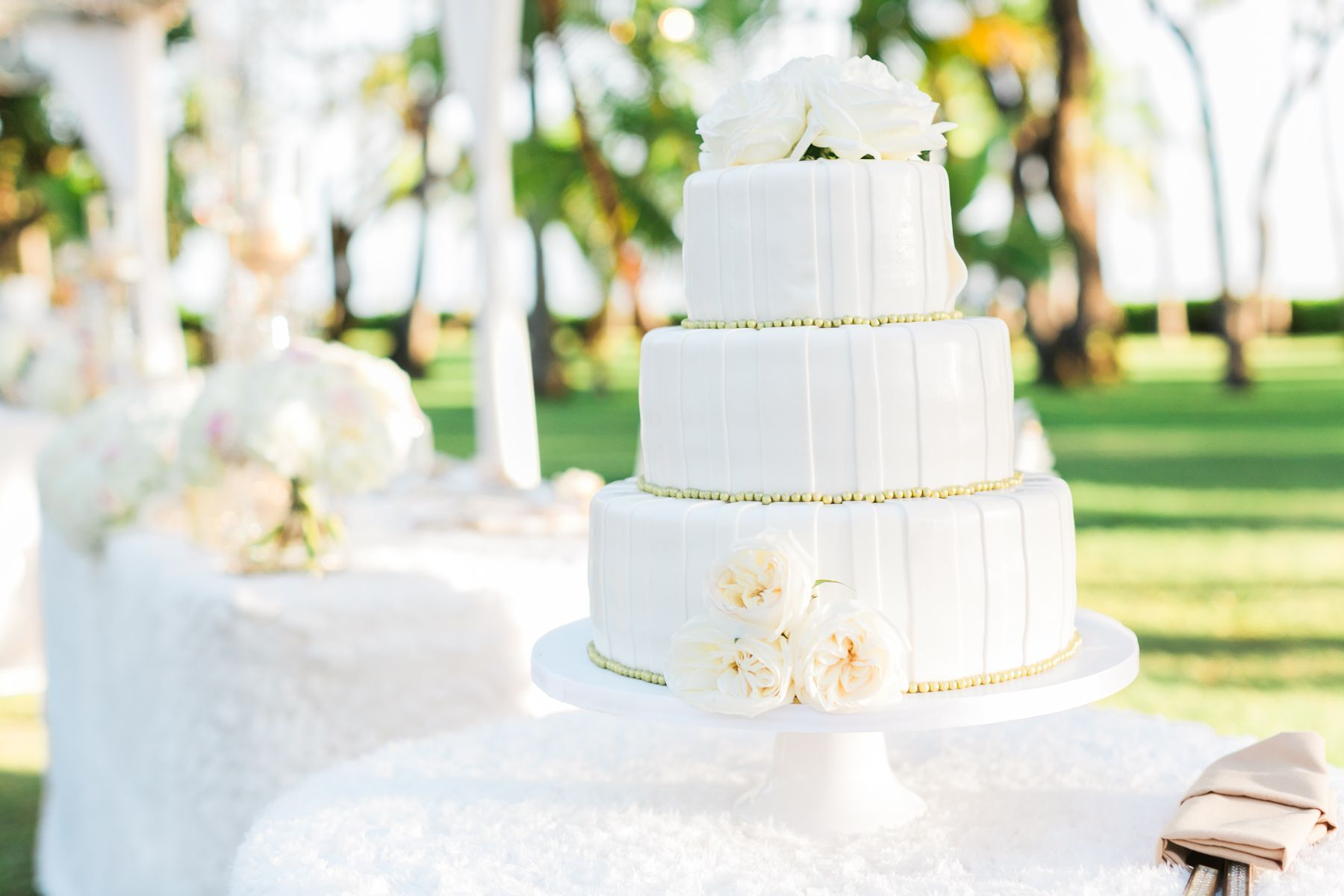 All white with gold pearls Wedding Cake