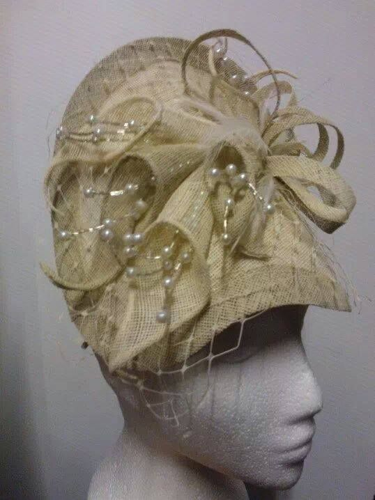 Cream and beige lilly style twist base hatinator.  93a4e7f94c3