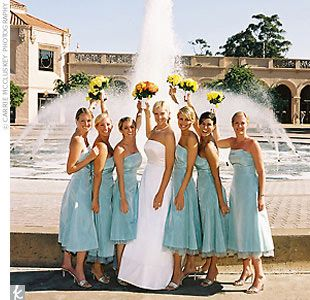 Jamie's six bridesmaids wore strapless capri blue Jim Hjelm Occasions matte taffeta gowns with exposed tulle at the hem.