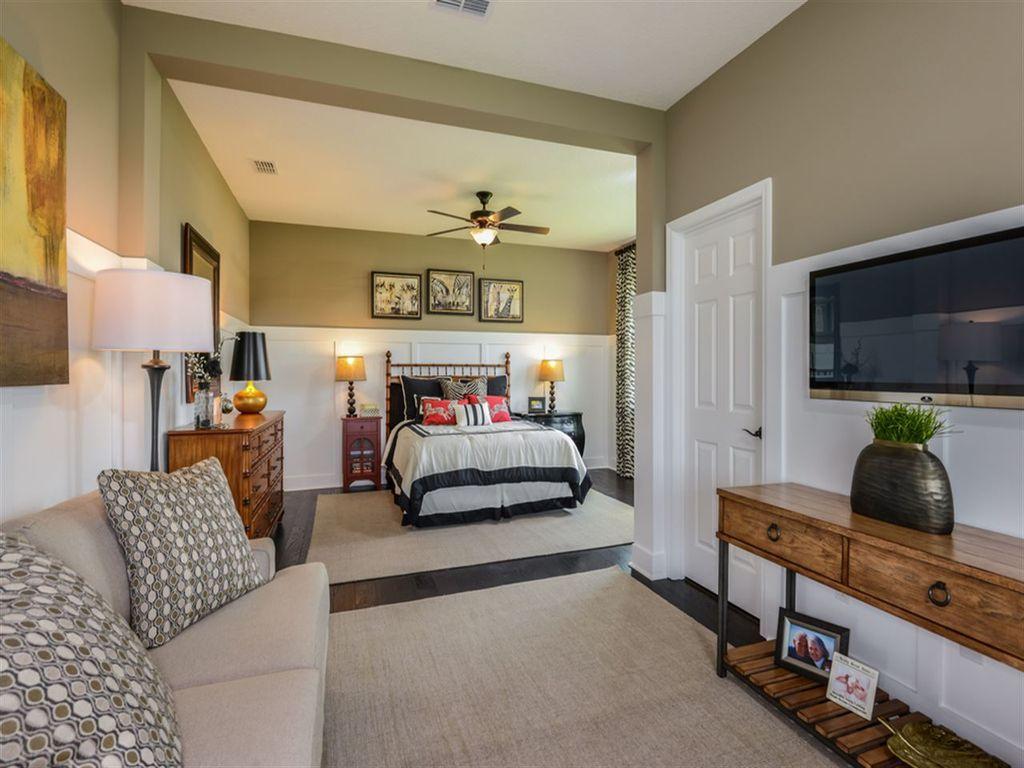 traditional master bedroom with flush light hardwood floors ceiling fan high ceiling