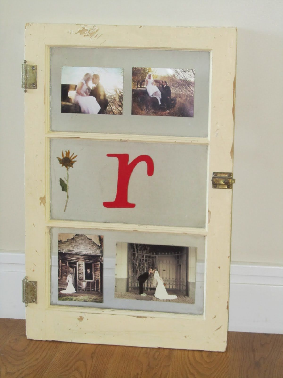 Window frame decor with wreath  made from an old window painted cream color and used a chisel to