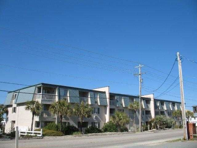 """Cherry Grove. Have you been waiting for a great buy on a beach """"getaway?""""  This is it, """"A Place at the Beach.""""   This two bedroom ocean view unit has been nicely updated with newer appliances yet has the original cottage appeal with the wood paneling.  Easy to paint or enjoy as it.  Extra storage room in hall, community pool and just steps to the beach.  Priced right and ready for quick sale.  Don't delay, call today."""