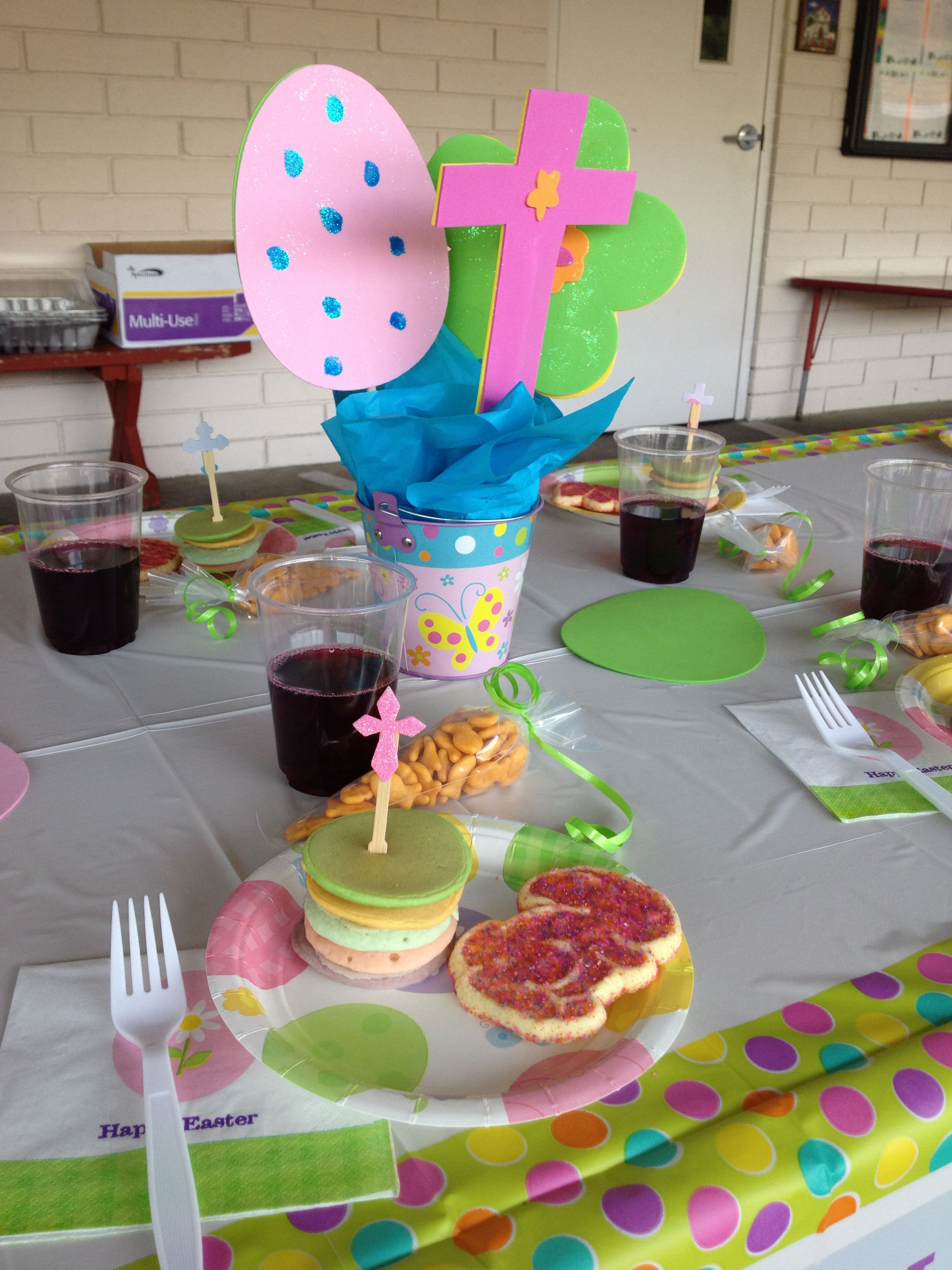 """1st grade Easter party! Made gold fish """"carrot"""" with frosting decorating bag. Center pieces are foam shapes and chop sticks. Another mom made the colored pancake stacks! Easy and fun! Kim : )"""