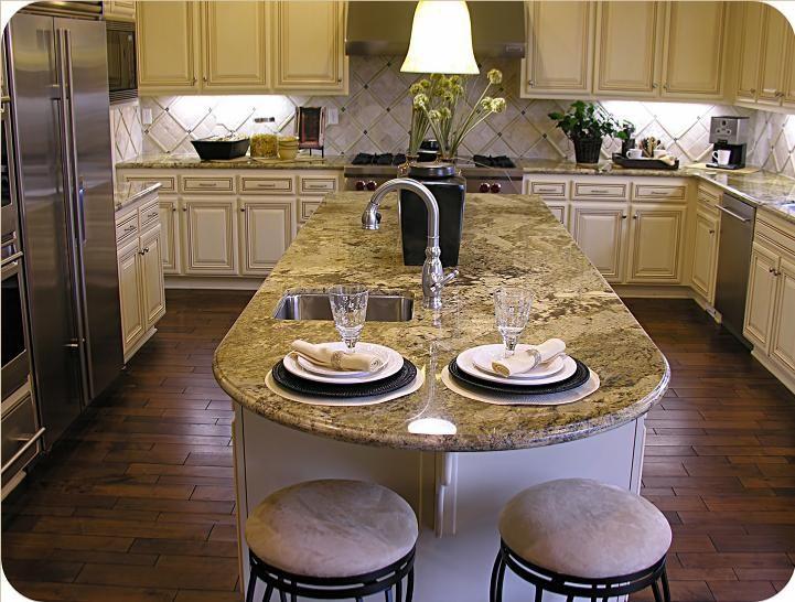 Netuno Bordeaux Granite Kitchen Countertops Featuring Exotic Granite Island.