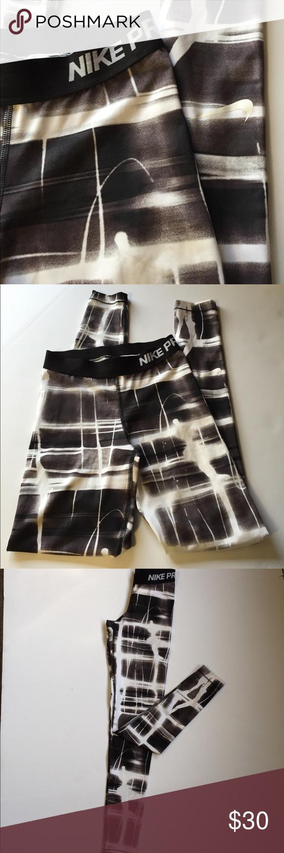 NIKE PRO Athletic Pants NIKE PRO Athletic Pants  -  80% polyester 20% spandex - fun black & white print - ankle length - size XS Nike Pants Track Pants & Joggers