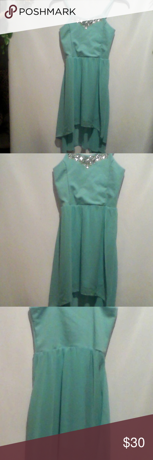 Sally Miller Mint green high-low dress. Sally Miller Mint green high-low dress. Rhinestone detail around collar. EUC. Please see photos for fabric and care info. Sally Miller Dresses Casual #sallymiller