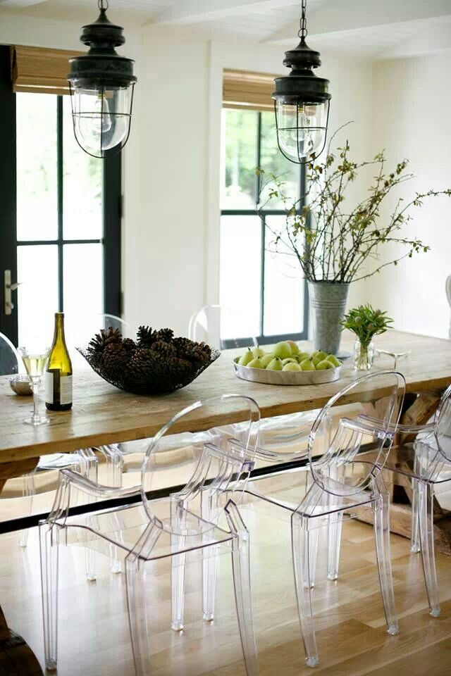 The Philippe Starck Louis Ghost Chair is both playful and whimsical and  works well to soften the harshness of this heavy rustic dining table. The Philippe Starck Louis Ghost Chair  love this chair  It is