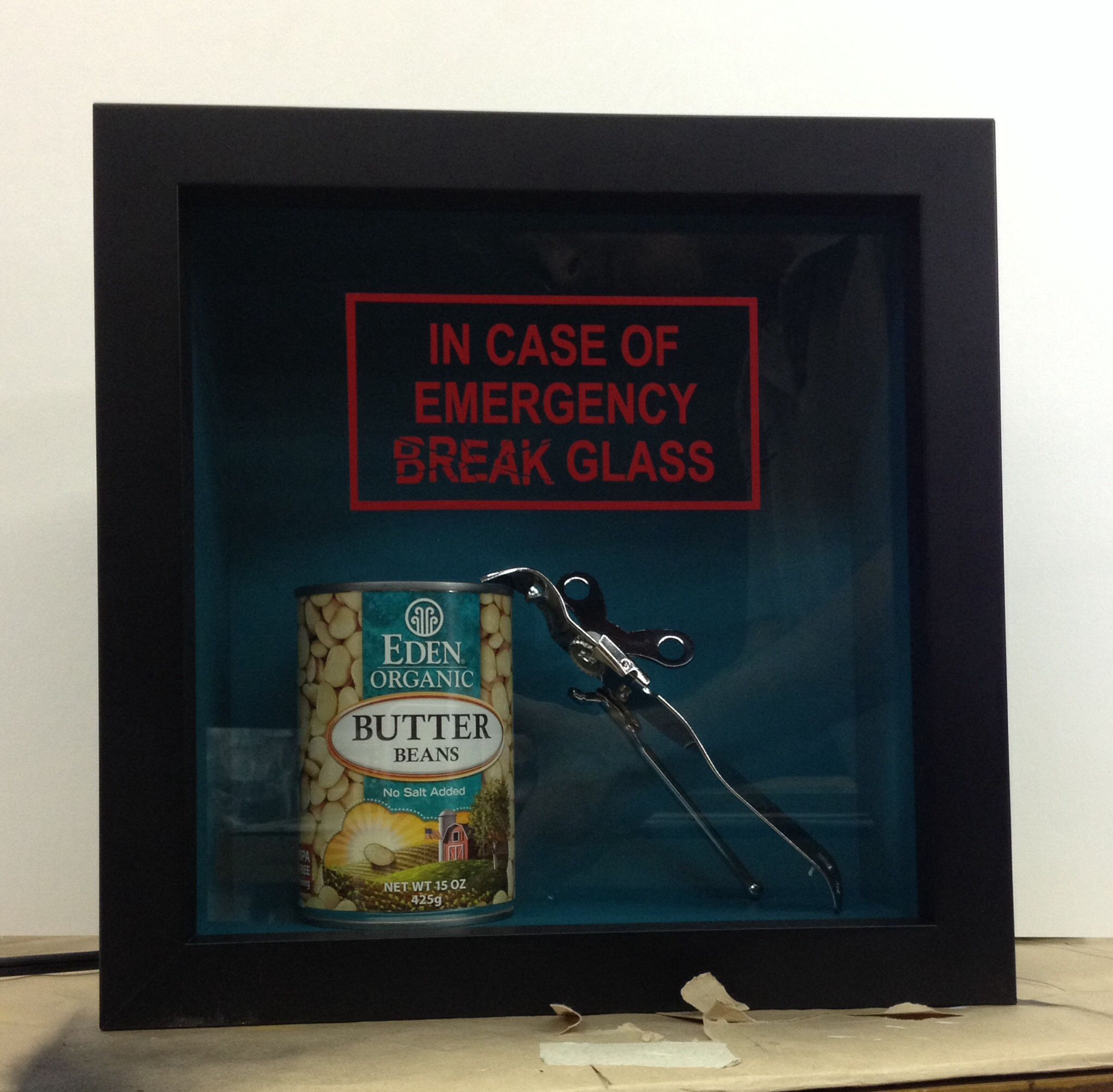 Framed as a joke...a can of Butter Beans and a can opener in a small ...