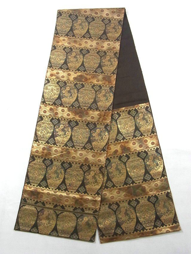 This is an unique and exotic Fukuro obi with vase on horizontal stripe pattern, which is woven by Hattori Weaving Co, one of the famous Nishijin Obi weavers