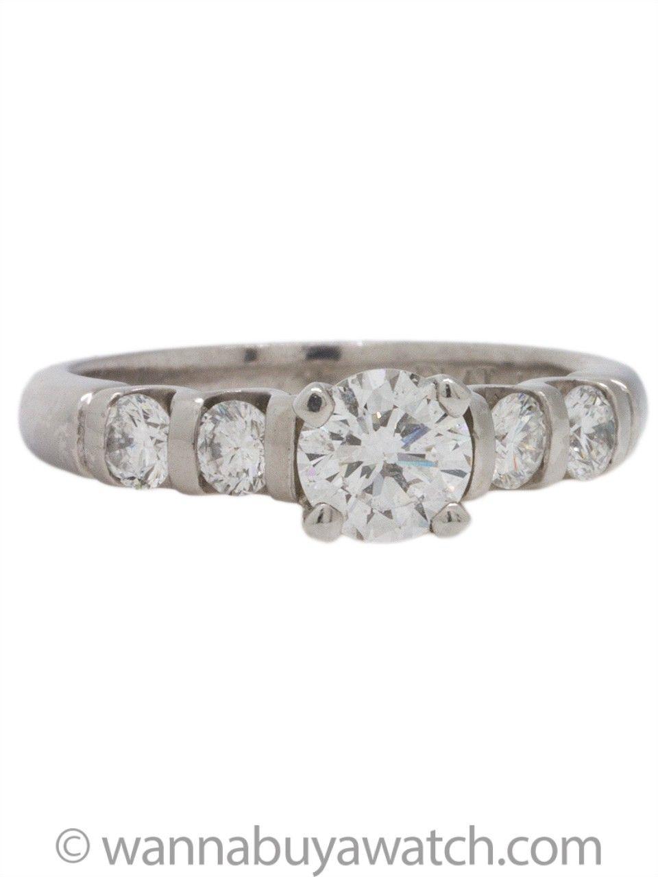 Sleek Substantial Contemporary Platinum Engagement Ring Showcasing A Fiery Igi Certified Round Brilliant Cut Four Bar Set Full Side Diamonds