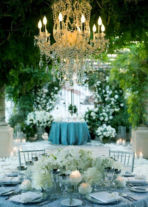 Green and silver, outdoor dinner setting.