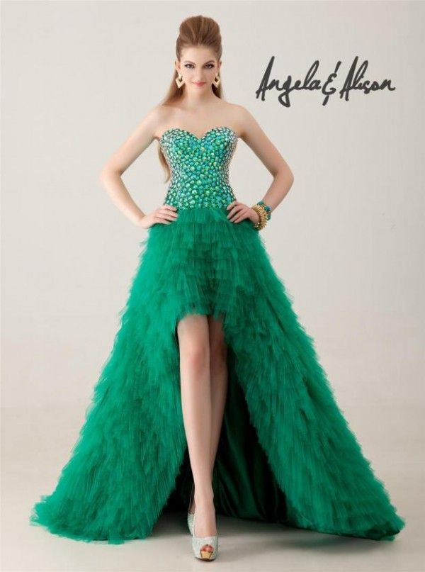 Short-front & long-back dresses could work for a salsa baile sorpresa! http://www.quinceanera.com/decorations-themes/mardi-gras-quinceanera/?utm_source=pinterest&utm_medium=article&utm_campaign=502-mardi-gras-theme