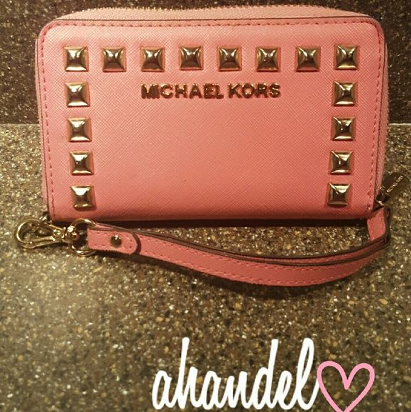 Michael Kors Studded Wallet Like new !! Still have the tags. Like new. It's a pig pink color :) 100%Authentic! Has been very well taken care of:) looking to trade and see what my options are! *Color may vary due to your device* Michael Kors Bags Wallets