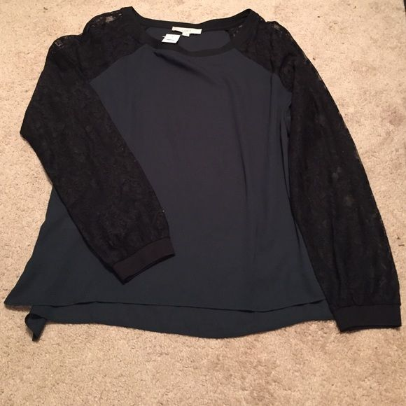 Green blouse with black lace sleeves Long sleeve, lace black lace with dark green body. New, never been worn. Super comfortable and relaxed feel but dressy blouse.  Send me an offer! LOFT Tops Blouses
