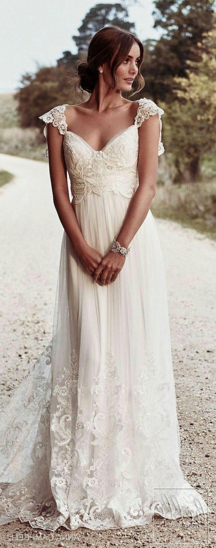 flowy wedding dress, vintage dress, made of lace and chiffon, brown hair, in a low updo #beachweddingdress #lacechiffon